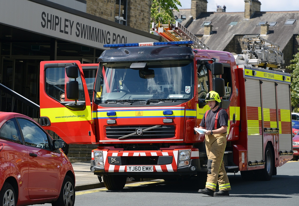 Firefighters outside Shipley swimming pool following the loud bang which forced the evacuation
