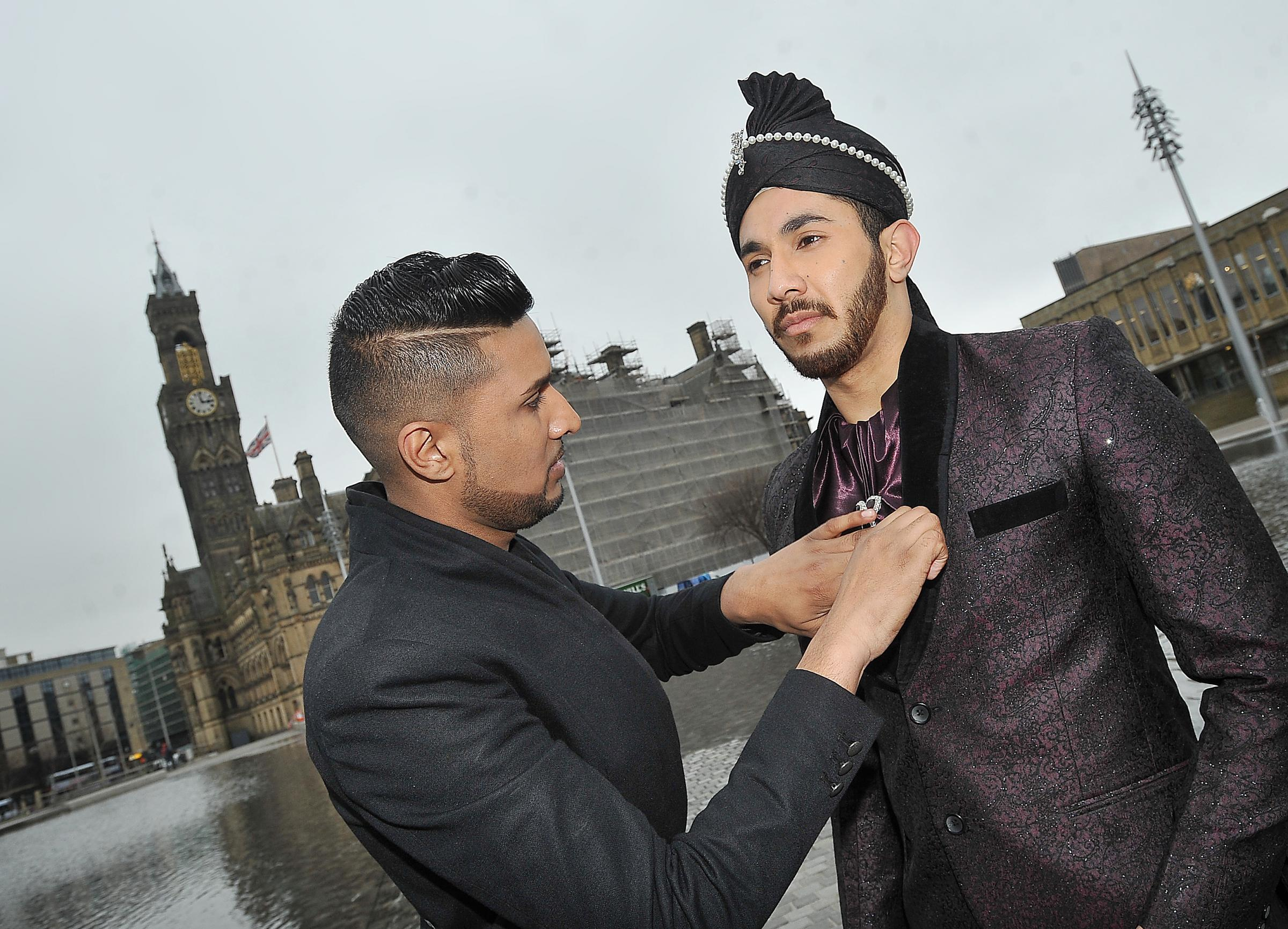 Designer Imran Khan, who has designed blazers popular with Bollywood stars and British celebrities, dressing model Waqas Sher