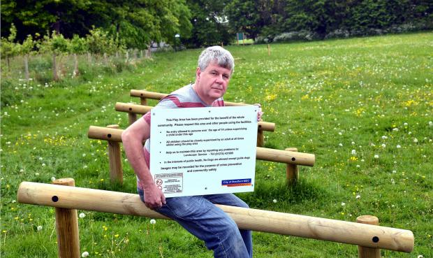 Ferniehurst Dell Improvement Group secretary Rob Higgie with the sign he has removed for its protection