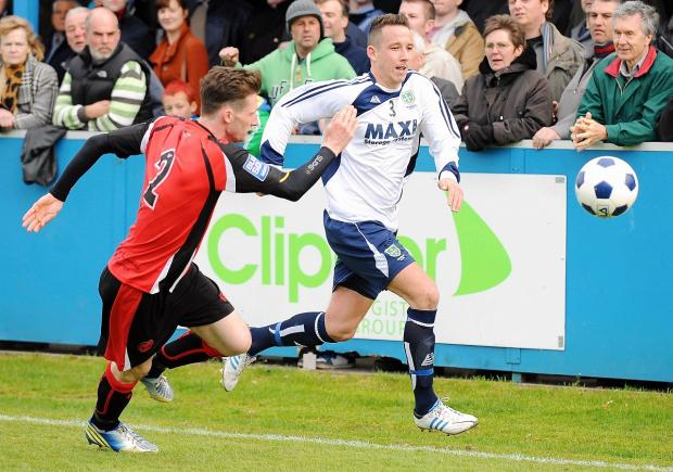 Halifax Town's Ryan Toulson, left, who is returning to Guiseley for a second spell, challenges Rhys Meynell, one of four players released by the Lions