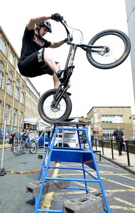 Cycle stunt show performer Rob Poyser shows off his skills at the Active Travel Street Party