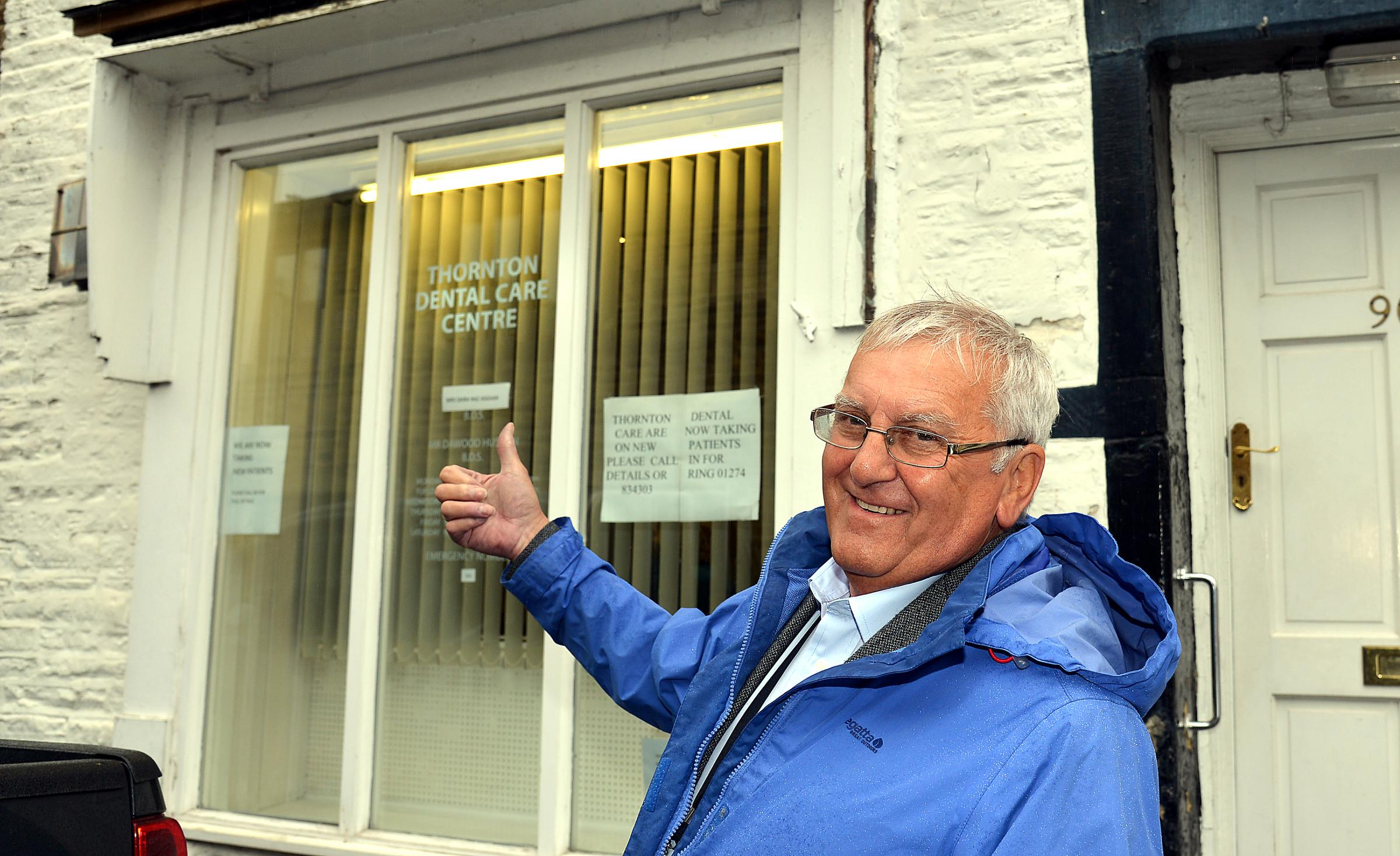 Councillor Malcolm Sykes outside the Thornton dental practice, which will now remain in the village