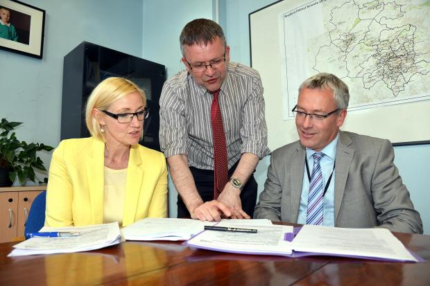 Reading the Ofsted review are (from left) Julie Jenkins, Councillor Ralph Berry and Michael Jameson
