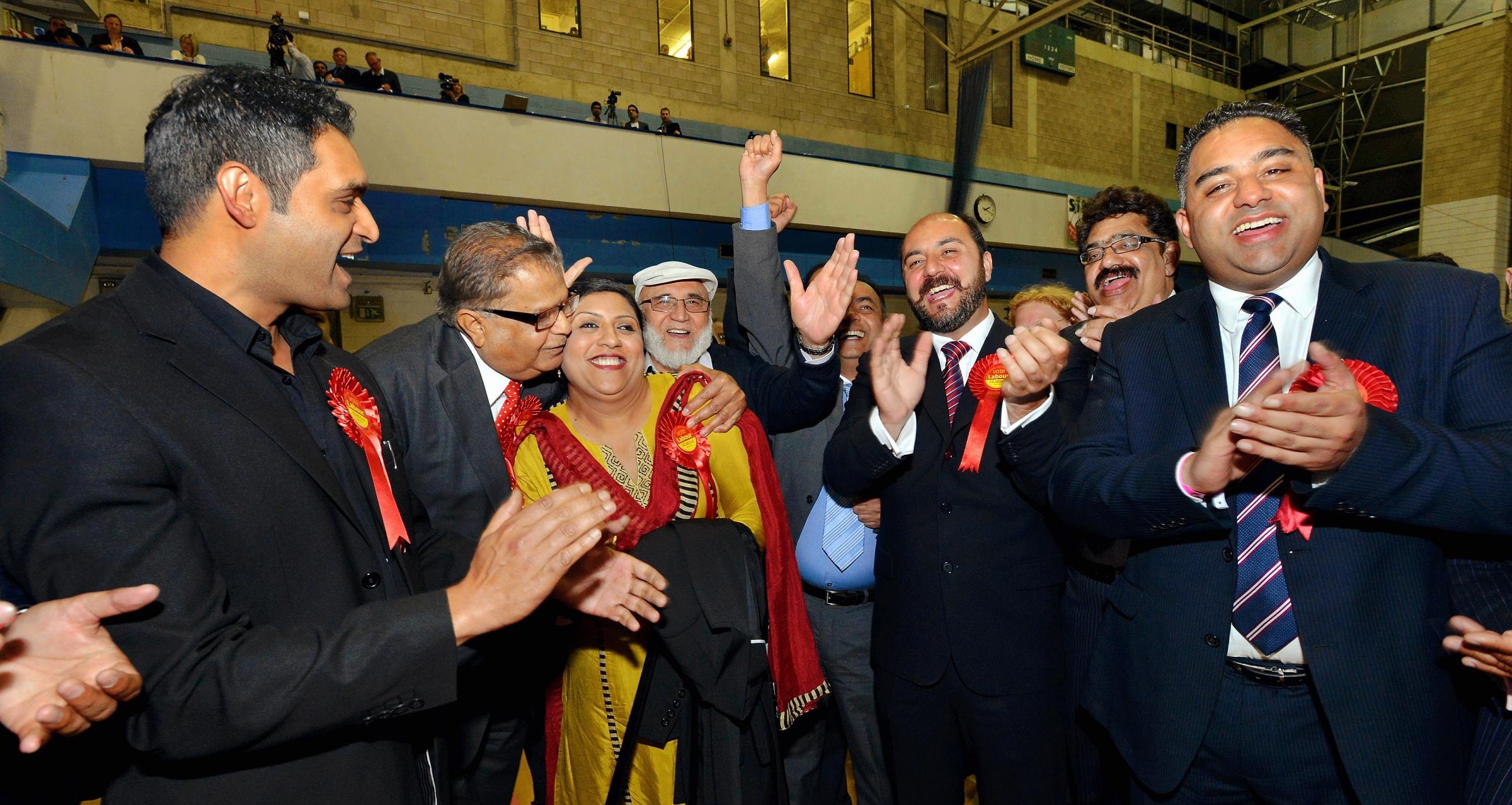 Members of Bradford Council's Labour group celebrate with Rizwana Jamil (centre), who won the Bowling and Barkerend seat