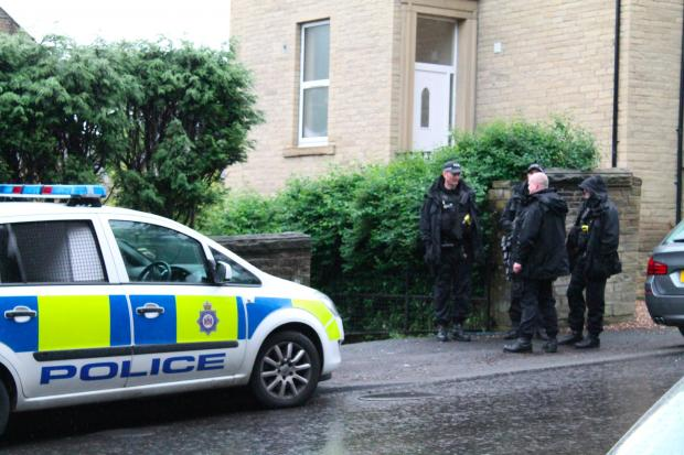 Officers during a police operation in Heaton yesterday