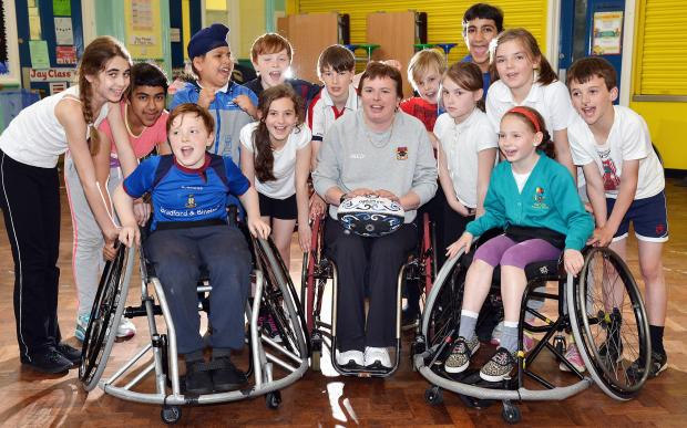 Gill Johnson, manager of Bradford Bulls disabled tag team, with pupils at High Crags Primary School, Shipley
