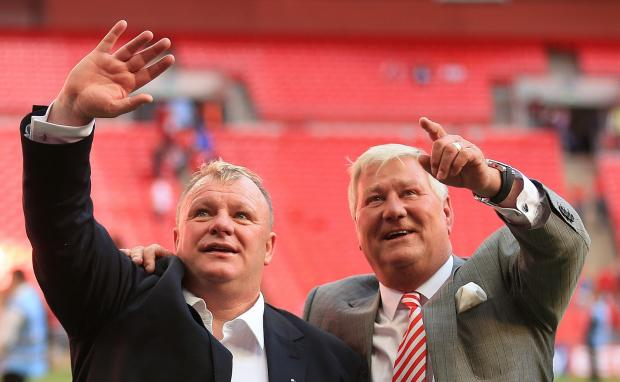 Steve Evans celebrates Rotherham's win in the League One play-off final with Millers chairman Tony Stewart
