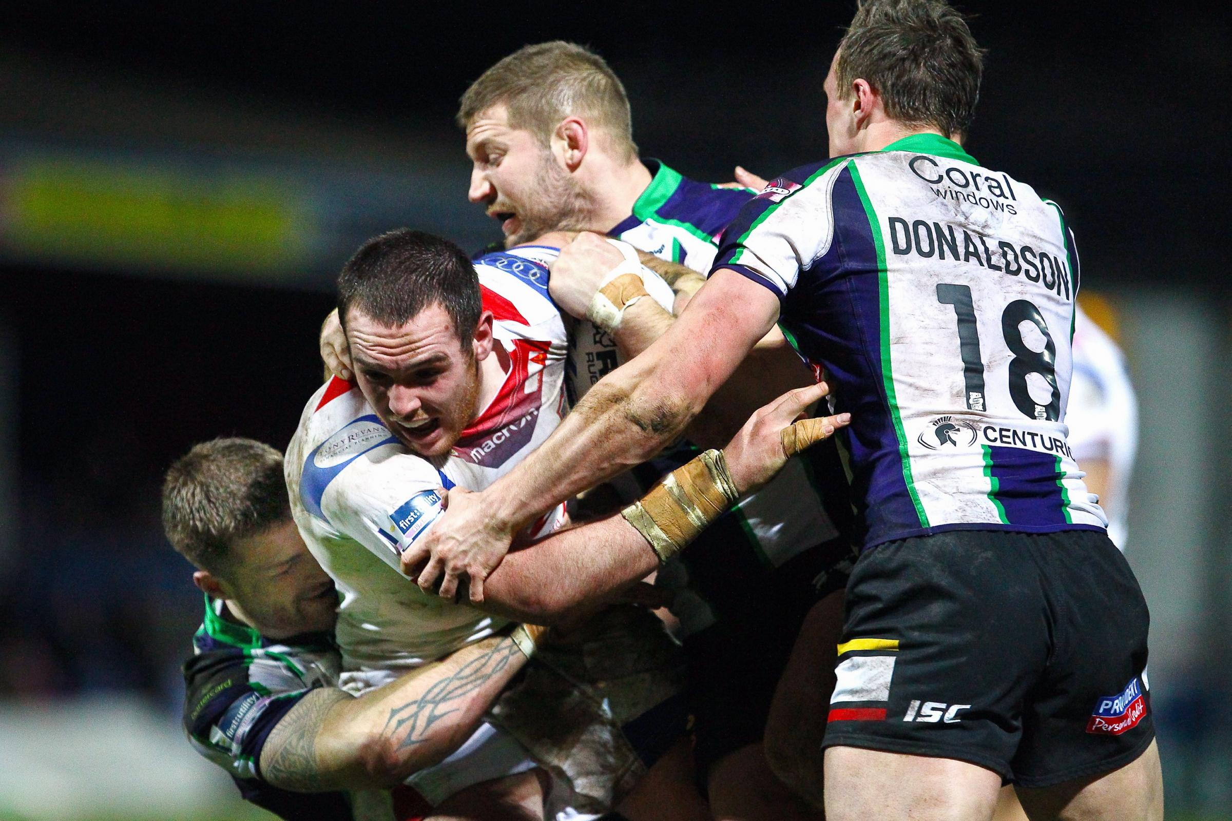 Nick Scruton helps make a tackle against future employers Wakefield during what was to be his final match in a Bulls shirt