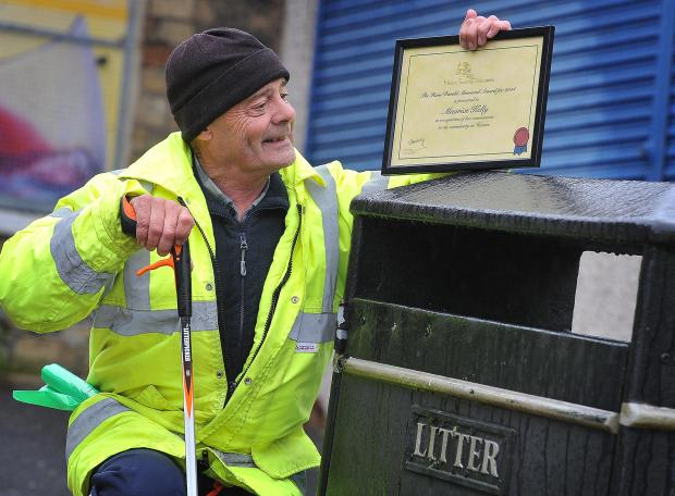 Street cleaner Maurice Kelly with his Hans Renold award from Heaton Township Association