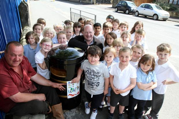 Silsden mayor Councillor Chris Atkinson, right, and Councillor Adrian Naylor with Aire View Infant School pupils at one of the litter bins that will bear posters designed by the children