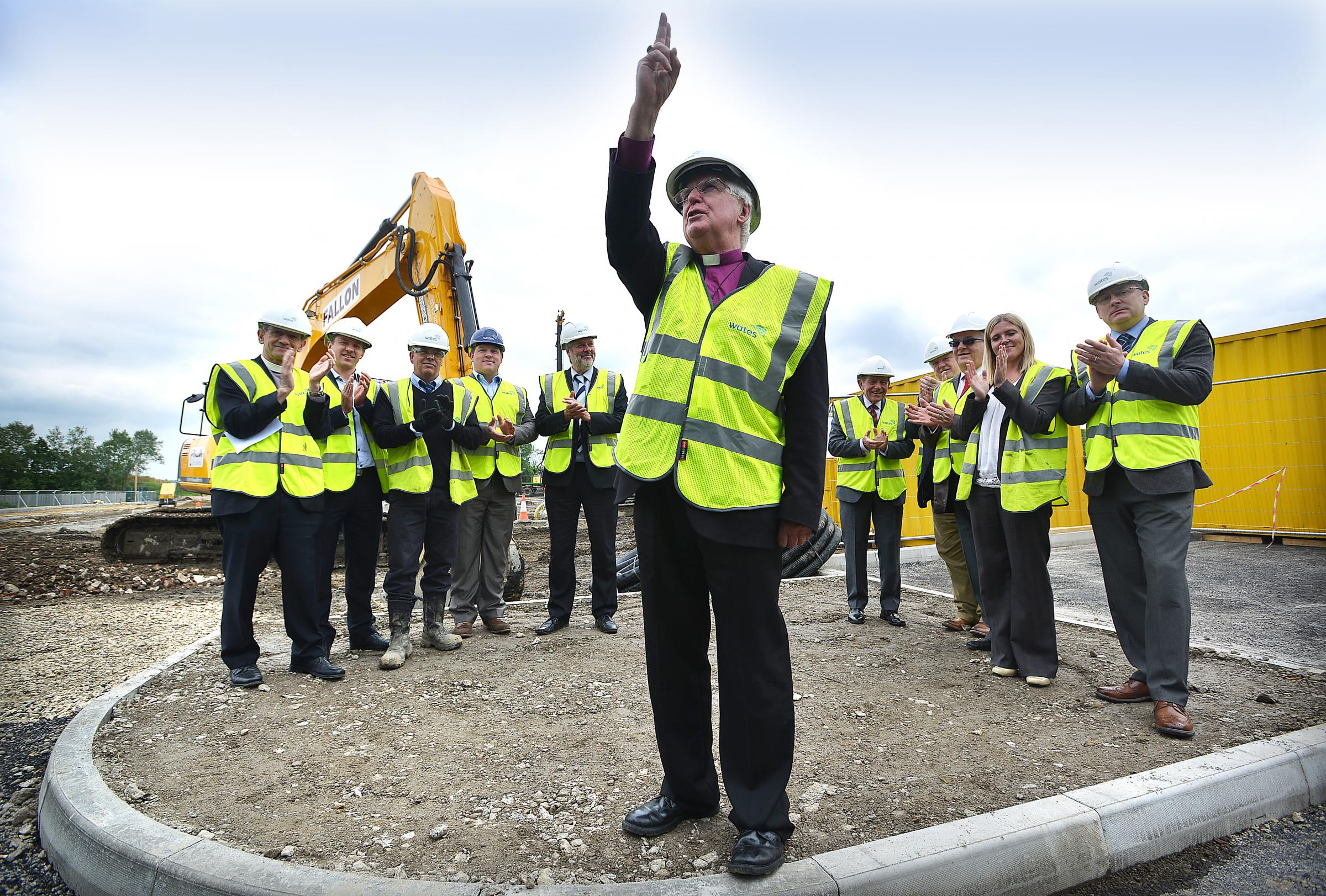 SERVICE: Acting Bishop of Bradford Tom Butler blesses the site of Bradford Forster Academy