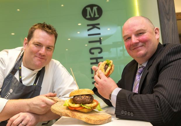 Peter Williamson and Simon Kelly are pictured testing the award-winning burger