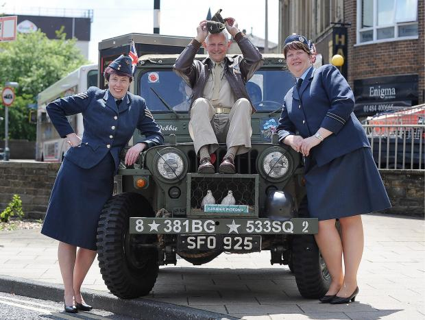 HYHY: Lesley Adams, John Wood and Anne Colley pose with a vintage vehicle for the 1940s weekend in Brighouse
