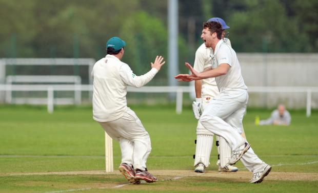 Bradford Telegraph and Argus: TOP DOGS: James Wilcock celebrates a wicket for Otley – the only unbeaten team in Division One – against Ben Rhydding