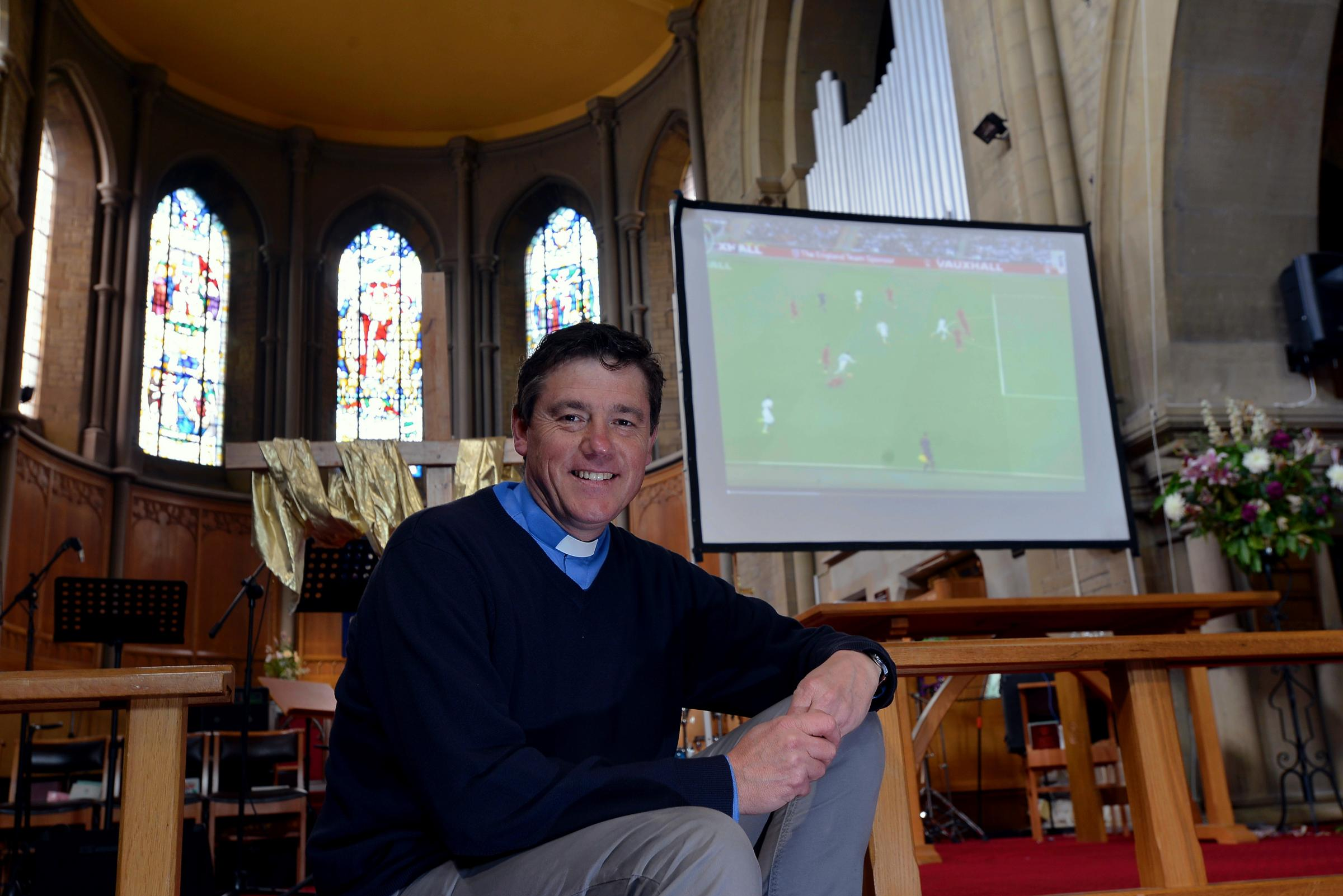 The Rev John Bavington, vicar of St John Church, Great Horton, is opening the church's doors over the World Cup
