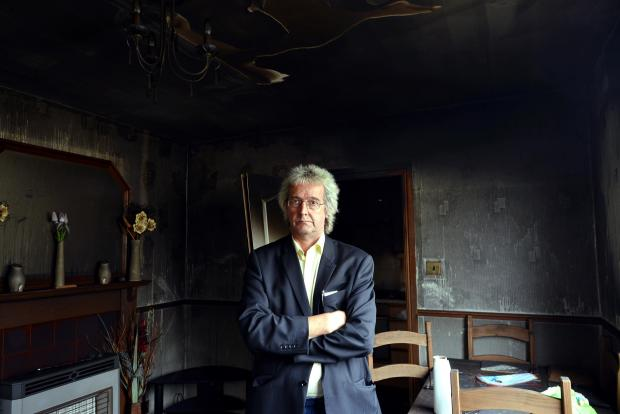 Roderick Stewart in his smoke-affected home