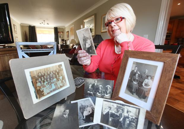 Wendy Cochrane with photos of her war hero grandfather Joseph William Nelson
