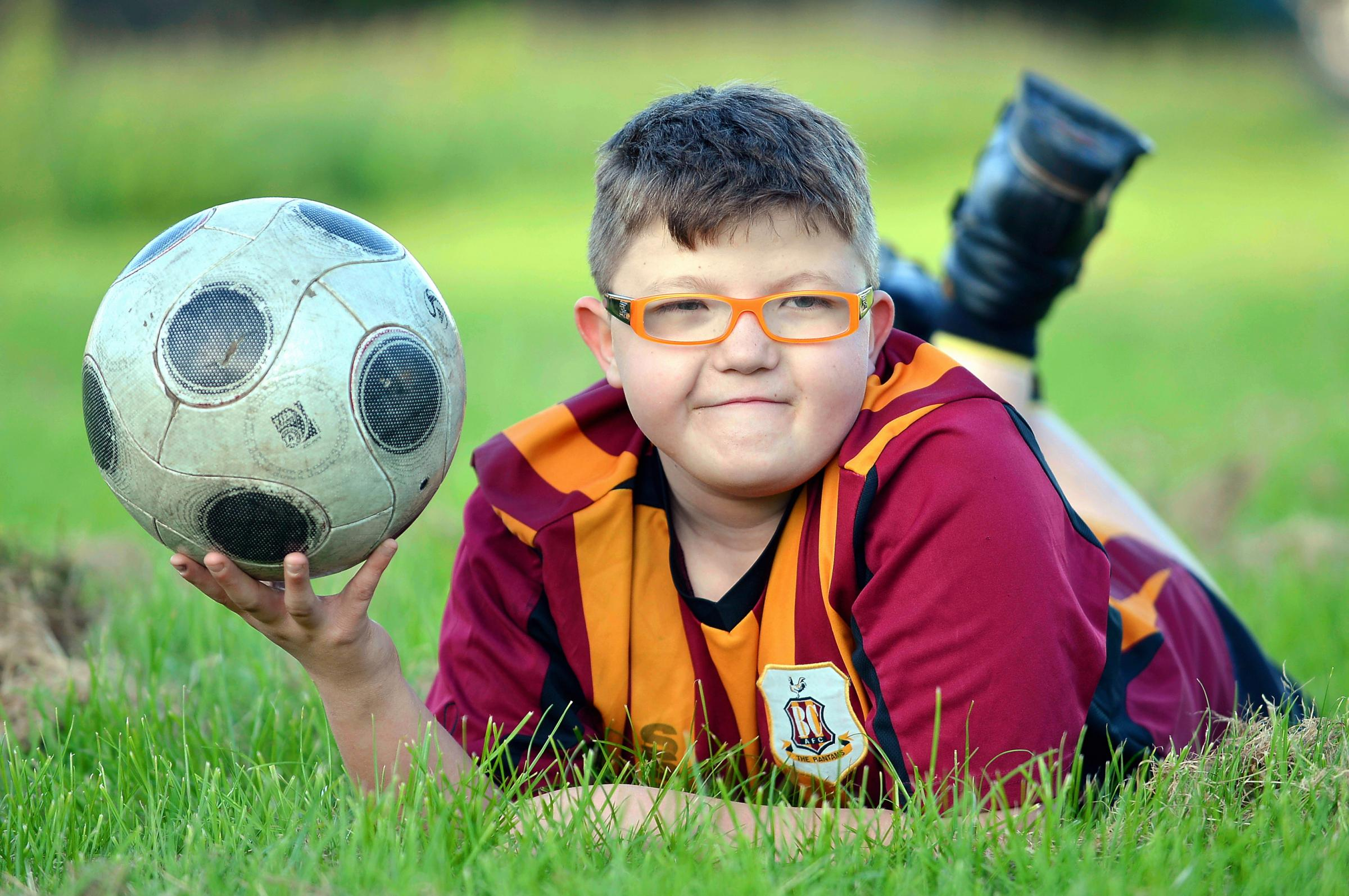 Footy-mad Joshua Turpin from Clayton, has defied medical opinion to reach his 13th birthday