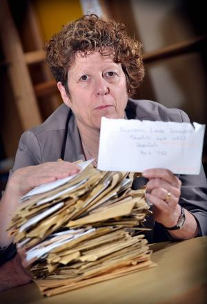 Councillor Jeanette Sunderland with some of the thousands of junk items sent to the Lib Dems' Freepost address