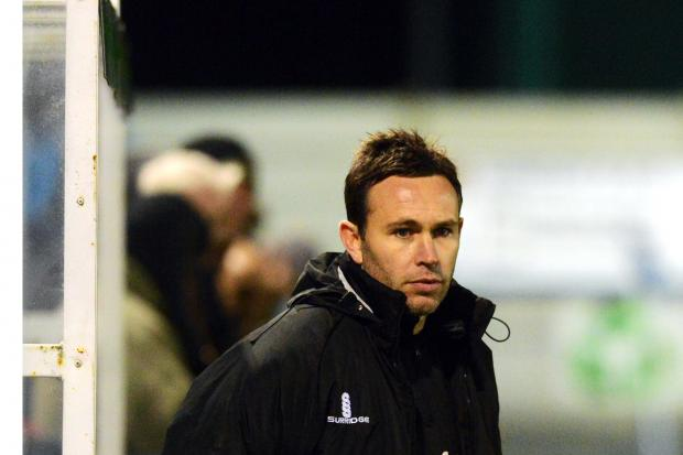 Guiseley manager Mark Bower offers advice to his players during a game (6957366)