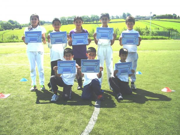 Farnham Primary School celebrate winning their qualifier at Great Horton Church Cricket Club