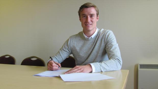 Stephen Darby puts pen to paper on his new three-year contract at City