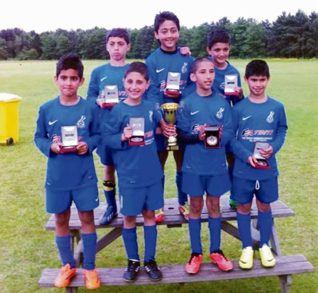 Woodhall United show off their medals