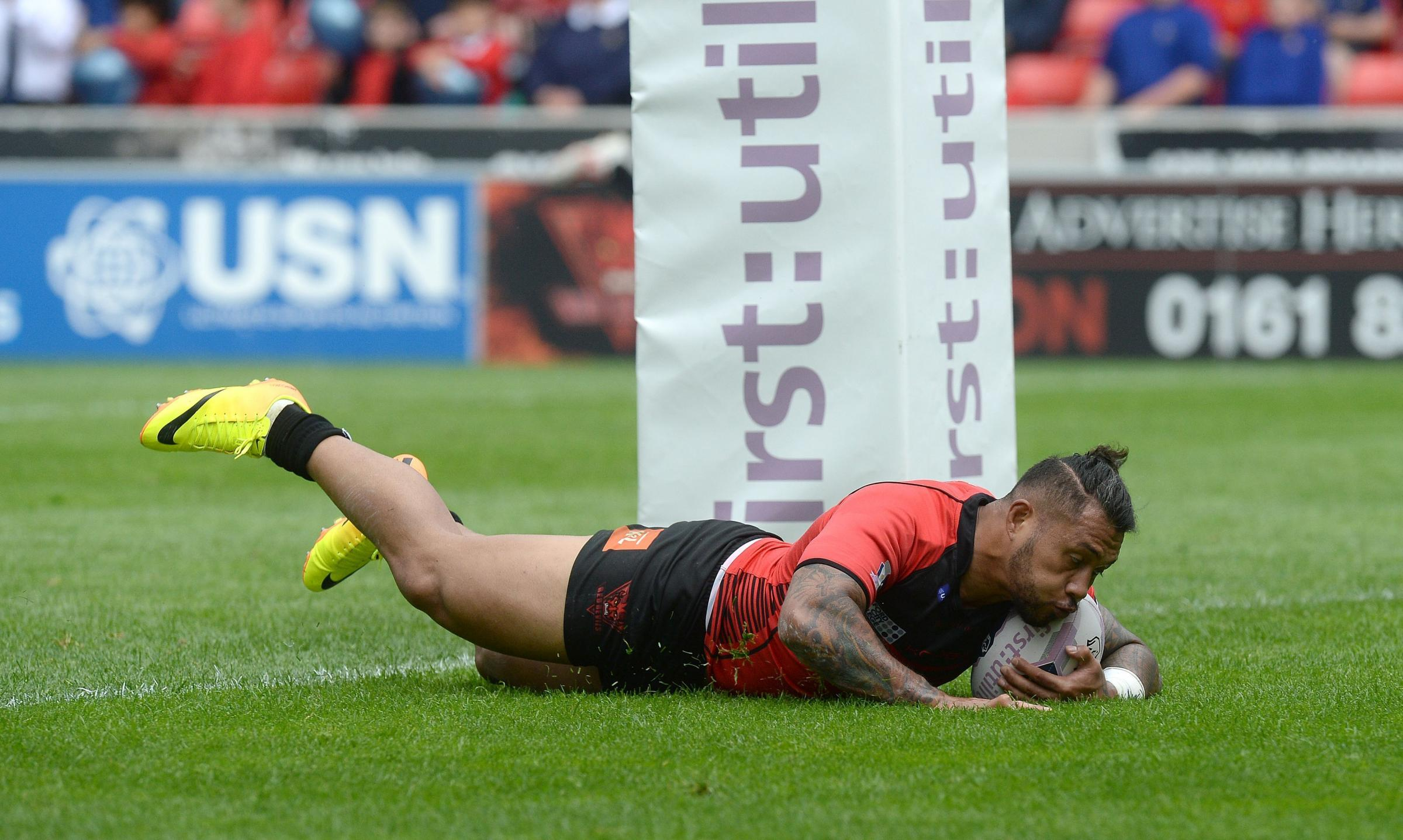 Junior Sa'u  goes over for his second try on a dismal day for the Bulls