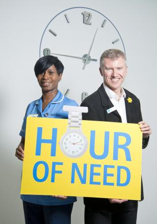 Marie Curie Bradford Hospice Nurse Lola Rowe and the Chief Executive of Yorkshire Building Society Group,  Chris Pilling, announce the Hour of Need fundraising campaign.
