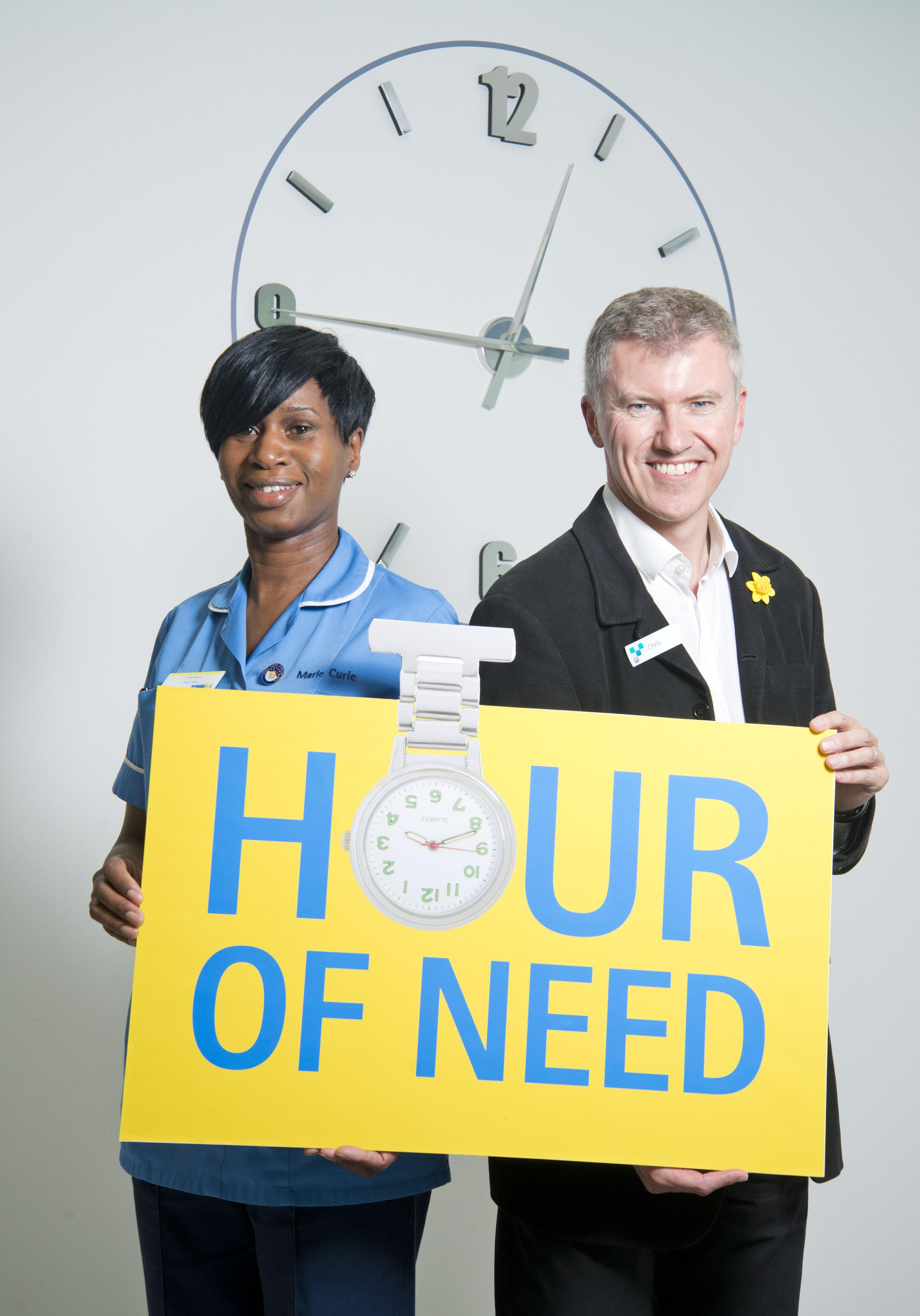 Marie Curie Bradford Hospice Nurse Lola Rowe and the Chief Executive of Yorkshire Building Society Group,  Chris Pilling, announce the Hour of Need fundraisi