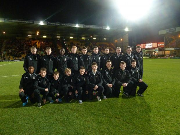 Bradford City's current futsal scholars pose for a team picture at Valley Parade