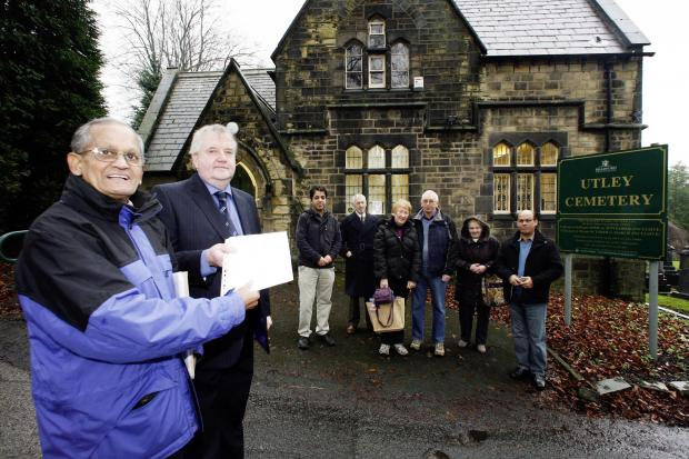 Bradford Telegraph and Argus: Charlie Bhowmick, left, hands over a petition in 2012 to opposing the proposed closure of the cemetery