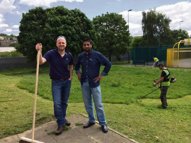 CLEAN-UP: From left, AWM Group Marketing Manager Mike Robinson and resident and voluntary worker Sajid Mahmood.
