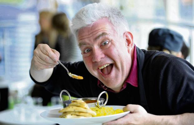 Bradford Telegraph and Argus: Yorkshire poet Ian McMillan attending last year's curry festival.