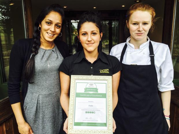 TOP CLASS:From left, Pesto supervisor Emma Manghra, waitress Rebekah Broady and head chef Stacey Lowe celebrate winning Tripadvisor's Certificate of Excellence.