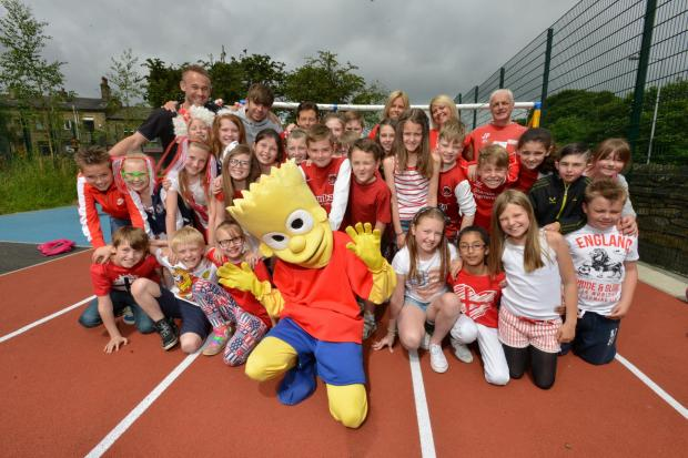 Children from Thackley Primary School enjoying a penalty shout-out with mischief maker Bart Simpson.