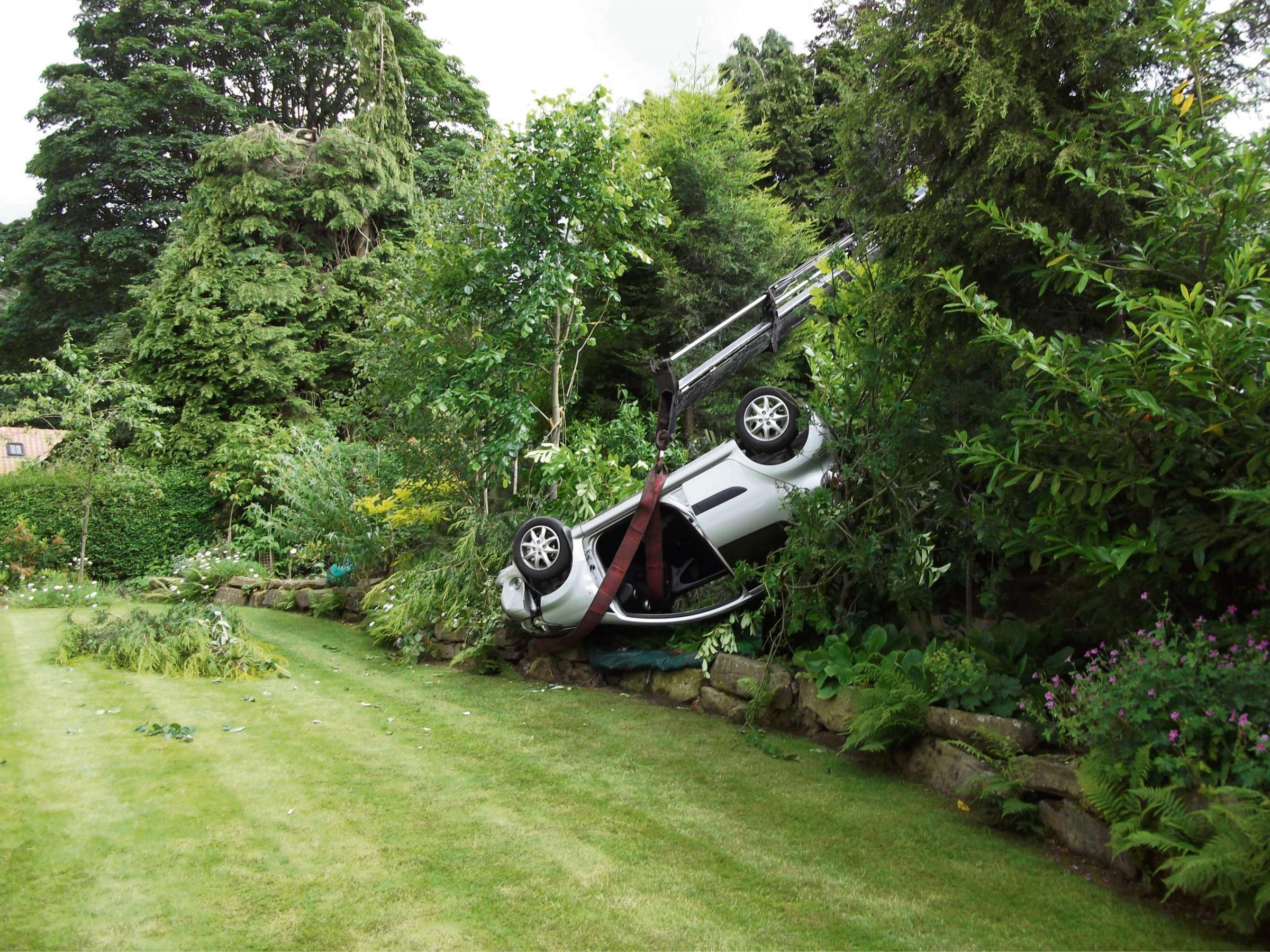 Two lucky to be alive after car ploughs into garden