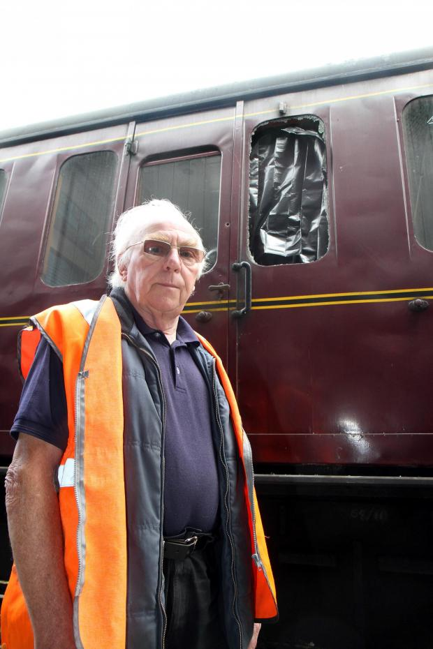 Bradford Telegraph and Argus: Keighley & Worth Valley Railway director Michael Tarran stands beside one of the carriages that were vandalised