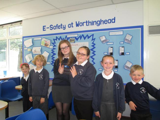 Pupils at Worthinghead Primary School with their award
