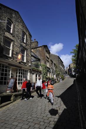 A sunny Bank Holiday scene in Haworth Main Street