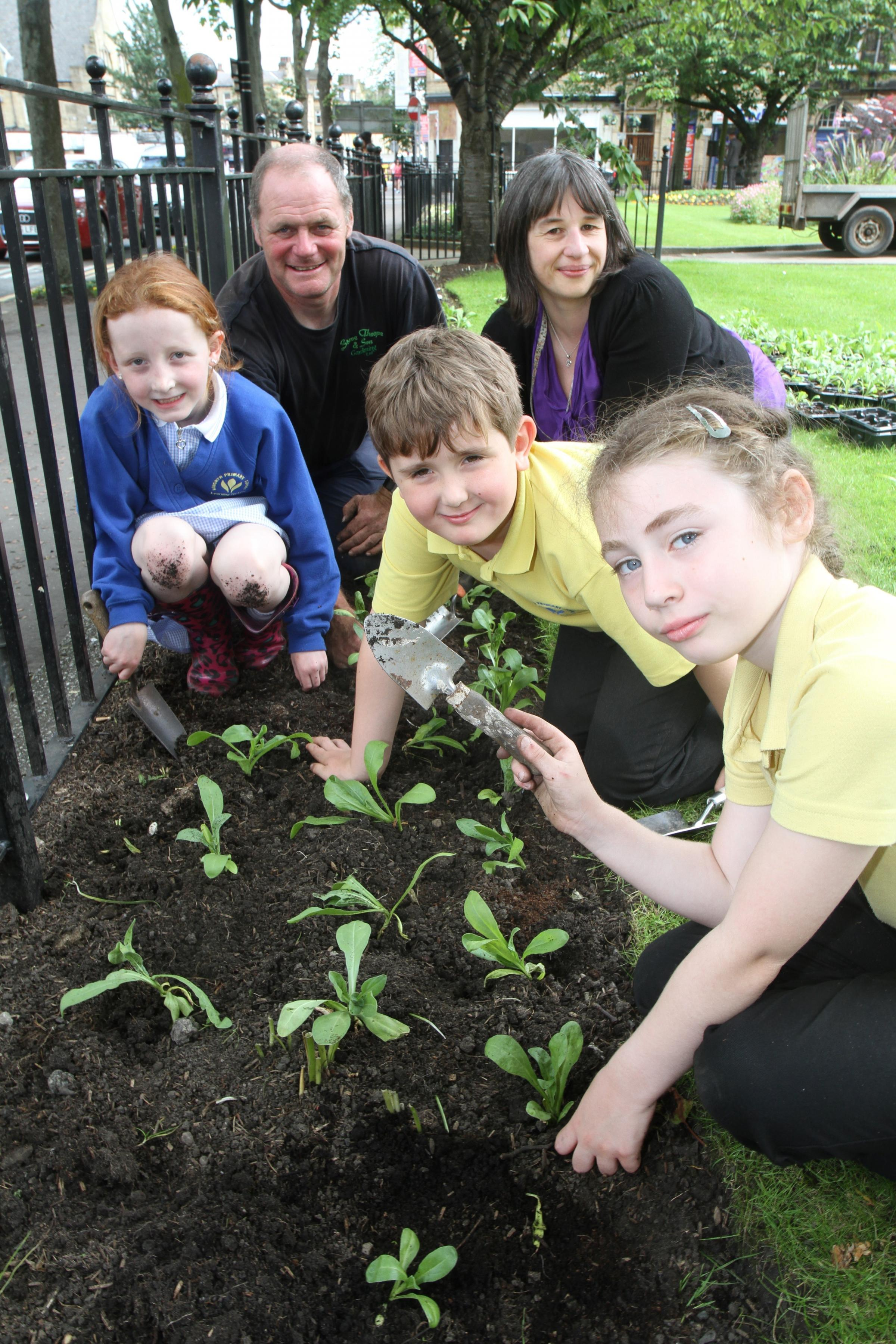 Haworth Primary pupils plant flowers in Keighley's Town Hall Square