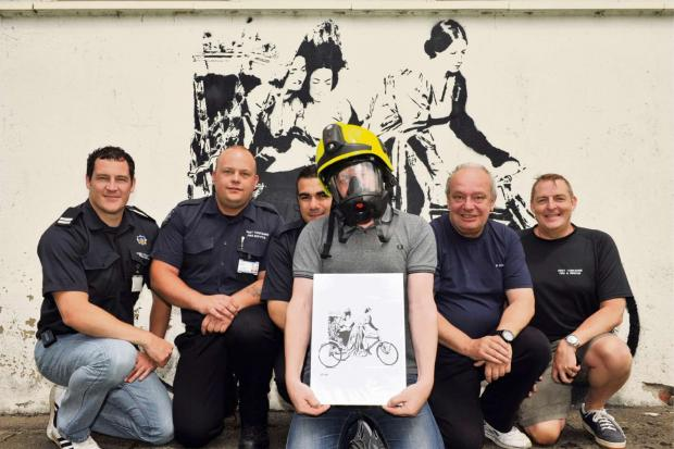 Street artist Stewy brings his unique style to Haworth Fire Station in celebration of Le Tour!