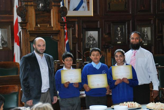 From left, SKT Welfare trustee Asif Hussain, with St Andrew's Primary School fundraisers Ibrahim Ahmed, Adil Ahmed, Aliyah Ramzan and Keighley Town Councillor Amjid Ahmed.