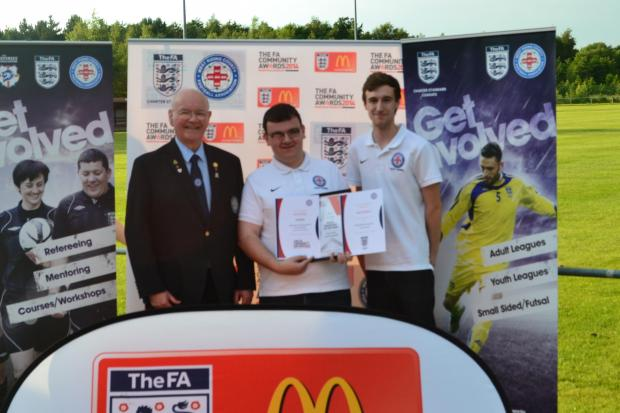 West Riding County FA life member Reg Allwood, left, presents their Young Volunteer of the year award to Tyersal secretary John O'Reilly. Alongside John is fellow West Riding County FA  youth council member Lee Maran, who is a referee