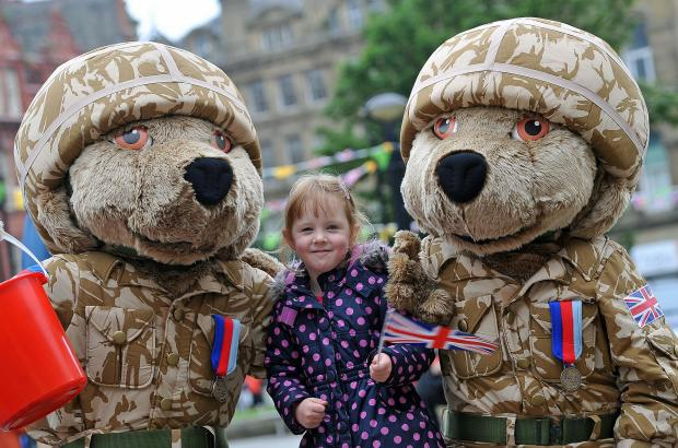 Bradford Telegraph and Argus: Olivia Fox with two Help for Heroes bears