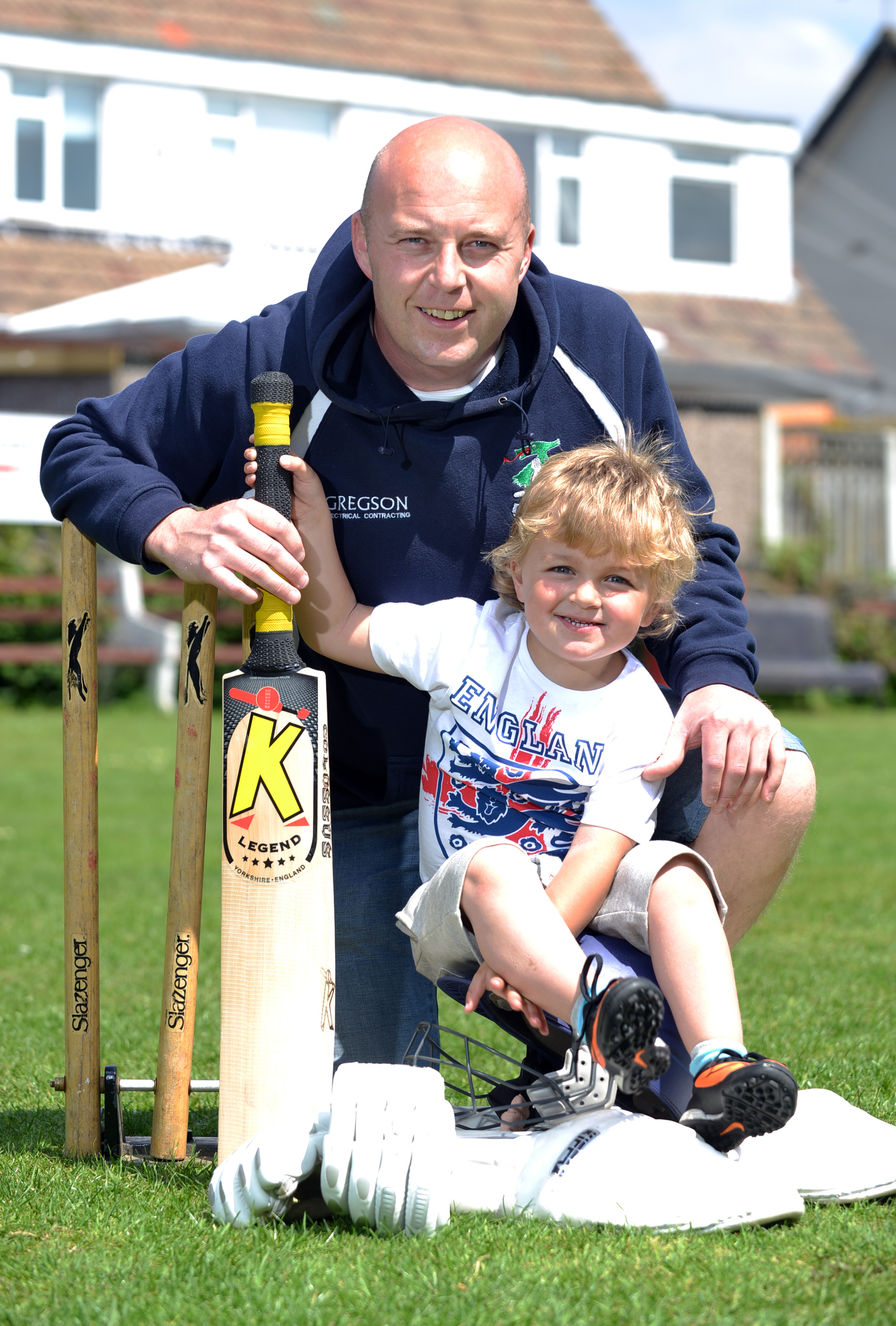 Paul Carroll, pictured with his son Billy, added 144 runs in 78 minutes with James Robson for Buttershaw