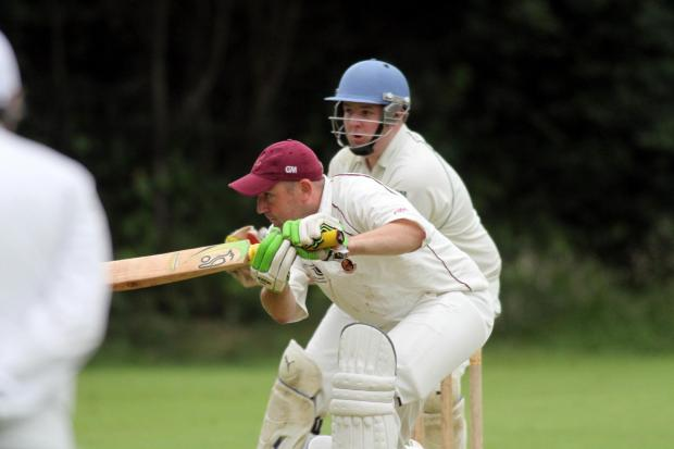 Bradford Telegraph and Argus: Opener Wayne Exley  gets down to it for Ingrow in their victory at Glusburn