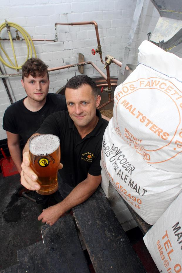 Bradford Telegraph and Argus: Dave Atkinson and his son Joe Atkinson at Goose Eye Brewery, Keighley, where a special Tour de France beer has been produced