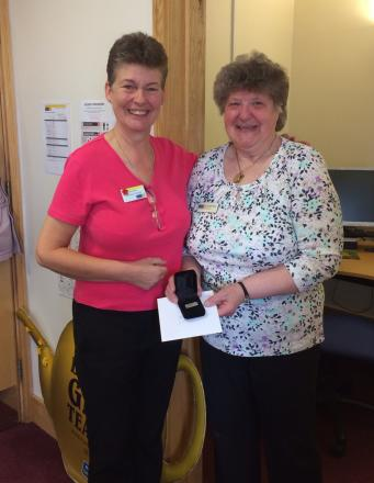 THANKS: Jacqueline Pickles, right, is presented with her ten year award by Jean Gordon