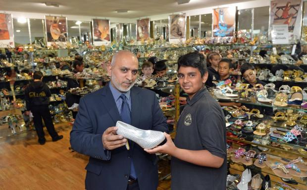 Bradford Telegraph and Argus: Bombay Stores MD Saleem Kader and Aadam Aktar look at one of the designs